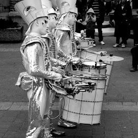 Drumline by DJ Cockburn - People Musicians & Entertainers ( monochrome, street performance, black and white, se18, silver, drummer, road, grayscale, england, london, woolwich, no 1 street, percussion, royal arsenal, tall ship festival, duke of wellington avenue, musician, crossroads, river thames )