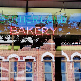 Reflection In A Bakery Window by Howard Sharper - City,  Street & Park  Street Scenes ( reflections, buildings, cityscape, downtown, street photography )