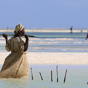 Zanzibar woman by Bim Bom - People Street & Candids ( zanzibar woman ocean water beach rest stick )