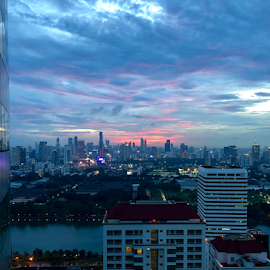 End of a rainy day by Frank Photography - Instagram & Mobile iPhone ( view, light, sunset, bangkok, skyscraper, skyline, clouds, evening )