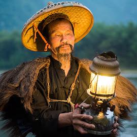 Fisherman's Lantern by Jim Harmer - People Professional People ( lantern, guilin, fisherman, china )