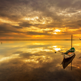 Precious Hour by Choky Ochtavian Watulingas - Landscapes Waterscapes ( clouds, reflections, cloudy, seascape, sunrise, boat, skies, golden hour )