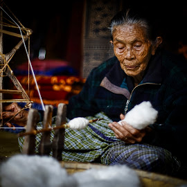 Old Lady and herl old spinning wheel by Indrawan Ekomurtomo - People Portraits of Women