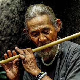 Old man & his flute by OC Andoko - People Musicians & Entertainers ( flute, human interest, musician, candid, old man )