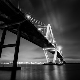 Skyline Evening Reflections of Charleston Bridge by Norma Brandsberg - Black & White Buildings & Architecture ( contracy, reflection, photograph, harbor, www.elegantfinephotography.com, suspension, horizon, cityscape, photo, norma brandsberg, photography, nbrandsberg@gmail.com, foggy, charleston, fog, award winning, sunset, vista, night, bridge, view, light, evening, hire )