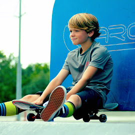 Resting while waiting my turn by Amelia Rice - Sports & Fitness Skateboarding ( skateboarding, sitting, bored, boy, skateboard, outside )