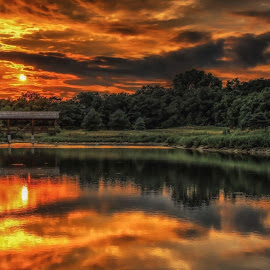 Bridges  by Casey Mitchell - Landscapes Cloud Formations ( clouds, sunset, reflected, lake, pond, sun )