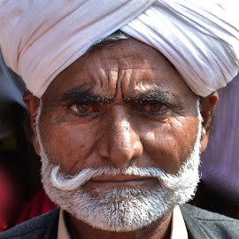 SERIOUS RAJASTHANI MAN POSING by Doug Hilson - People Portraits of Men