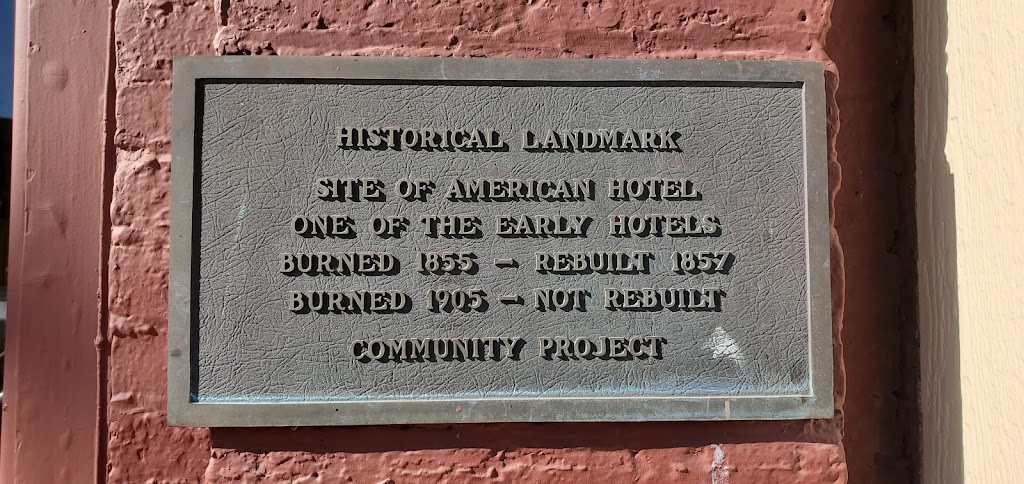 HISTORICAL LANDMARK SITE OF AMERICAN HOTEL ONE OF THE EARLY HOTELS BURNED 1855 -- REBUILT 1857  BURNED 1905 -- NOT REBUILT COMMUNITY PROJECT