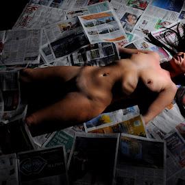 Enchained in the News by DJ Cockburn - Nudes & Boudoir Artistic Nude ( art nude, model, lying, dark hair, home shoot, white, supine, jess harrington, caucasian, off camera flash, woman, brunette, newspaper )