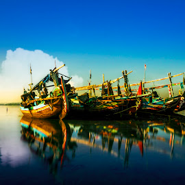 Anchored  by Ade Irgha - Transportation Boats ( explore bali, bali, boats, kelan beach, reflections )