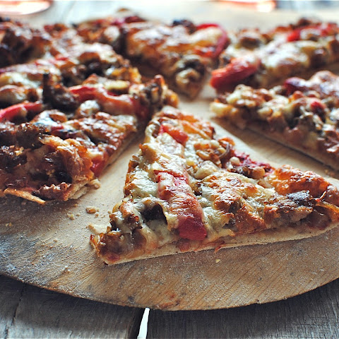 Thin Crust Pizza with Caramelized Onions, Sausage and Roasted Red Peppers
