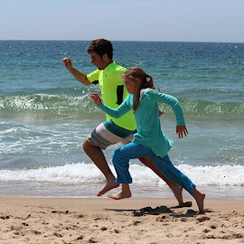 racing on beach by Sarah Beth - People Family