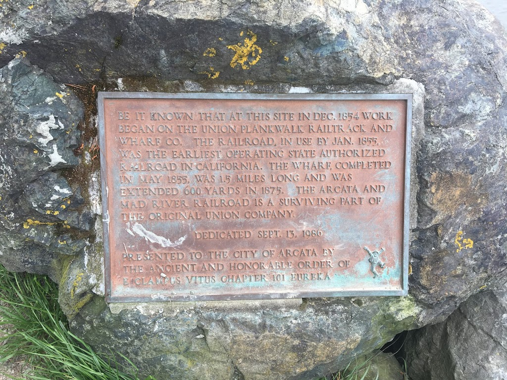 Plaque text:  Be it known that at this site in Dec. 1854 work began on the Union Plankwalk Railtrack and Wharf Co. The railroad, in use by Jan. 1855, was the earliest operating state authorized ...