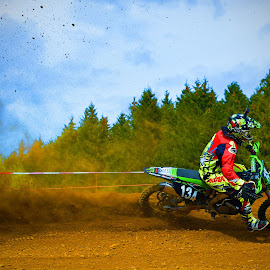It's Raining Clumps! by Marco Bertamé - Sports & Fitness Motorsports ( curve, sky, red, drifting, motocross, blue, green, dust, cloudy, clumps, race, accelerating, competition )