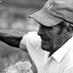 Old man by Cristobal Garciaferro Rubio - People Portraits of Men ( collector, old man, flowers, man )