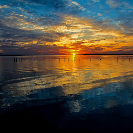 Bay Fire by Wendy  Walters - Landscapes Waterscapes ( mississippi gulf coaast, dusk on the mississippi gulf coast, mississippi gulf coast sunset, gulf of mexico, bay of st. louis )