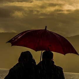 Lost in the moment . by Gordon Bain - People Couples ( dusk ., loch ness, rain )