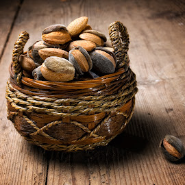 Almonds basket by Sinisa Botas - Food & Drink Fruits & Vegetables ( raw, nobody, almond, shell, nutshell, seasonal, retro, heap, macro, nature, full, fresh, protein, ingredient, pile, closeup, isolated, fruit, dry, obsolete, seed, beautiful, kernel, snack, tasty, organic, wooden, food, basket, healthy, nut, brown, natural )