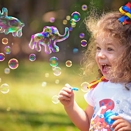 Bubble Fun by Charlotte Hellings - Babies & Children Child Portraits ( love, colour, bubble, girl, color, family, bubbles, beauty, fun, imagination )