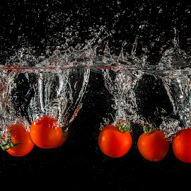 Tomatoes by Dumitru Doru - Food & Drink Fruits & Vegetables ( water, red, splash, tomato, food, vegetables, vegetarian, light, tomatoes, black )