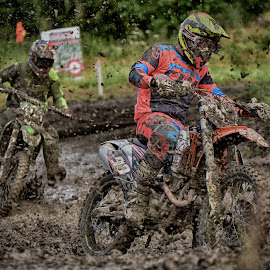 Muddy Curve by Marco Bertamé - Sports & Fitness Motorsports ( speed, green, 90, number, yellow, race, noise, two, mud, red, motocross, blue, clumps, brown, duel, accelerating )