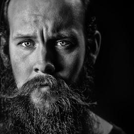 the Norseman by Bendik Møller - Black & White Portraits & People ( model, monochrome, black and white, male, close up, portrait, eyes, close, black background, beard, mono, mustache, man )