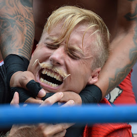 Smile! by Thomas Shaw - Sports & Fitness Other Sports ( ring, wrestling, gloves, finger, wrestling ring, pro wrestling, raleigh, the works, teeth, gouge pro wrestling, blonde, hands, tattoos, gouge wrestling, match, men, hair, mustache, man )