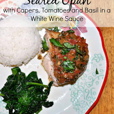 Seared Opah with capers, tomatoes and basil in a white wine sauce