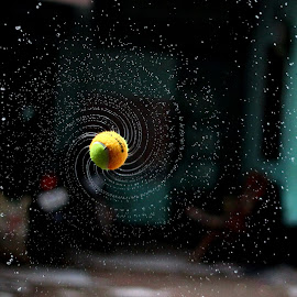 Spinning wet tenis ball by ডাঃ মুহাম্মদ হাসান - Artistic Objects Other Objects ( water rays, ball spin, fast shutter, water splash, wet ball )