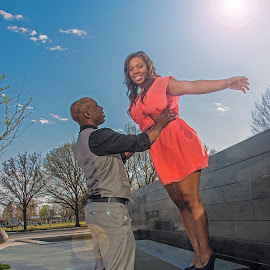 He Gives Her Wings by Kathy Suttles - People Couples ( african american, happy, couple, lifting, portrait, engagement )