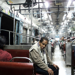 by Subrata Chatterjee - News & Events Health ( old age, west bengal, india, train compartment, south east asia )