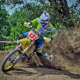 Dust Storm ! by Marco Bertamé - Sports & Fitness Motorsports ( curve, drifting, motocross, speed, slittering, dust, clumps, number, yellow, 131, race, accelerating, noise )