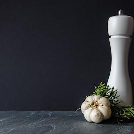Flavor by Dan Ungur - Food & Drink Ingredients ( garlic, salt, grinder, restaurant, salt grinder, food, stone, flavor, presentation, dark, ingredients, kitchen, spices )