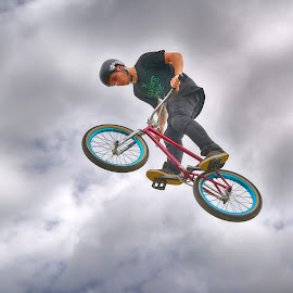 Sky Rider by Marco Bertamé - Sports & Fitness Other Sports ( clouds, wheel, dow, helmet, stunt, jump, flying, red, blue, cloudy, grey, air, high )