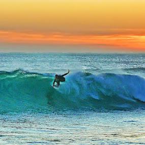Surfing at Sunset by Daniel Schwabe - Sports & Fitness Surfing ( pwcwatersports, rio de janeiro, green, sunset, wave, saquarema, surf, brasil )