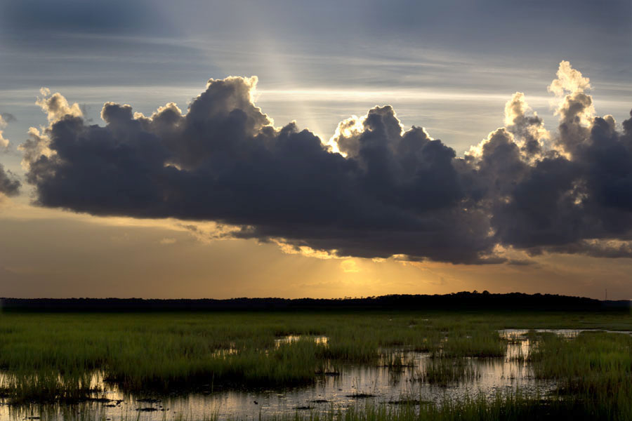 Sunburst  by Carlos Holt - Landscapes Prairies, Meadows & Fields ( clouds, water, sunburst, jekyll, sunset )