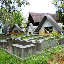 Tombstones in a cemetery  by Rahmat Nugroho - Buildings & Architecture Places of Worship ( sorrow, tomb, christian, old, christianity, sad, cemetery, stone, sandstone, one old, burial, religion, nature, fallen, gravestones, headstone, buried, monument, place, dead, distress, blank, memorial, symbol, park, burial space, grass, death, art, white, patio, grave, grieving, graveyard, tombstone, statue, outdoors, outdoor, gravestone, religious, cross )