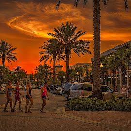 Girl Crossing by Pat Lasley - City,  Street & Park  Street Scenes ( girls, sky, colorful, florida, sunset, palm trees, john's pass )