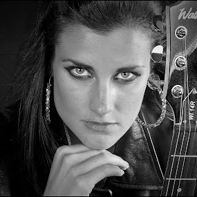 Musical lady by Adrian Chinery - Black & White Portraits & People ( cool, jacket, music, female, woman, lady, rock, musician, beauty, leather, eyes,  )