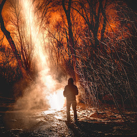 Arrival by Mike DeMicco - People Portraits of Men ( silhouette, woods, smoke, fire, portrait, skye, snow, dark, trees, arrival, beam, alien, night, light )