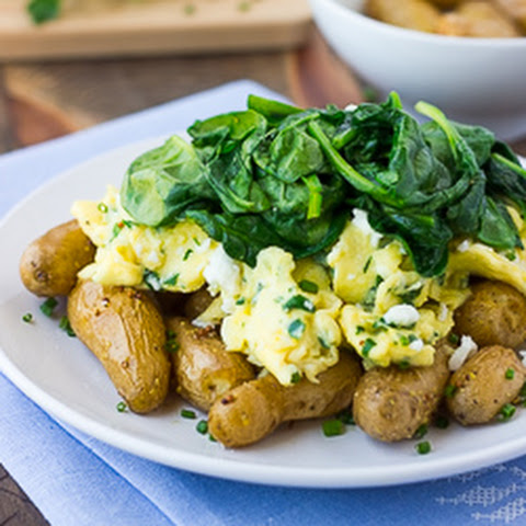 Herbed Goat Cheese Scrambled Eggs with Roasted Potatoes and Spinach