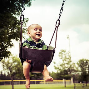 My first time on the swing by Frederic Rivollier - Babies & Children Babies ( laughing, theodore, baby, fun, swing, babies, cute baby, cute )