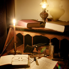 Seeing the Light of History by James Baker - Artistic Objects Antiques ( office, books, flask, reading, glasses, desk, research, candle, adventure, oil lamp, lamp, book, antique, knife, bullets )