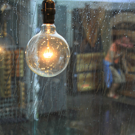 A Light in the Storm by Kate Purdy - Artistic Objects Glass ( reflection, lightbulb, window, woman, glass, summer, weather, raindrops, storm, rain,  )