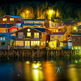 by Christian Roger Costanzo - City,  Street & Park  Night ( wooden houses, on water, houses on water, houses, palafitos, castro, america del sur, lights, chile, colored houses, chiloé, south america, night, chilli )