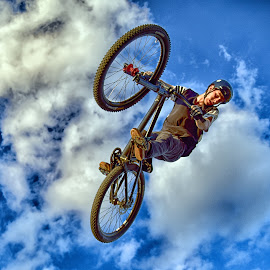 Flying On Wheels by Marco Bertamé - Sports & Fitness Other Sports ( clouds, two, sky, wheel, blue, air, high, dow, stunt, jump, bicycle )