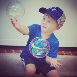 Catching Bubbles by Michelle Ruggiero-Carpenter - Instagram & Mobile Android ( cool, child candid, bubbles, grandson, nike )