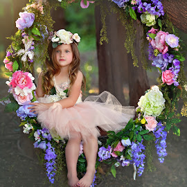 Spring Swing by Carole Brown - Babies & Children Child Portraits ( brown eyes, pearls, floral swing, trees, brown hair, tulle dress )