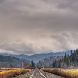 Heading to the Mountains by Michelle Cox - Landscapes Mountains & Hills ( stormy, mountains, railroad tracks )